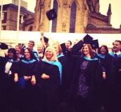 Delighted University of Huddersfield students celebrate their graduation